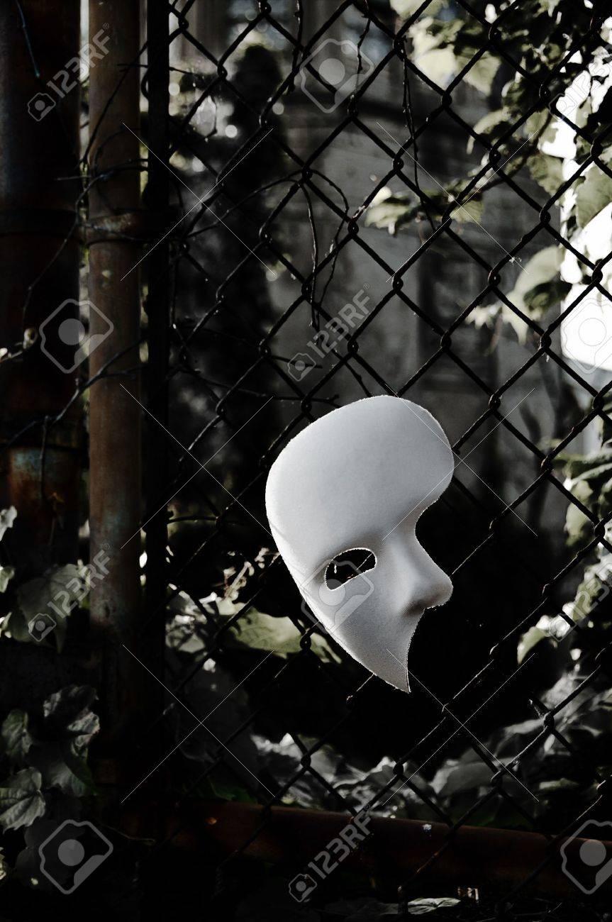 Masquerade - Phantom of the Opera Mask on Rusty Chainlink Fence Stock Photo - 14206439