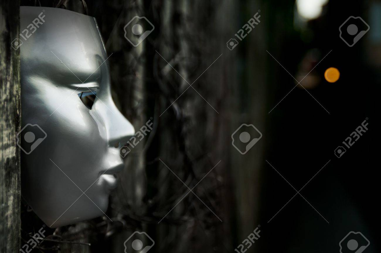Trapped - Mask on Weathered Fence Stock Photo - 15534858
