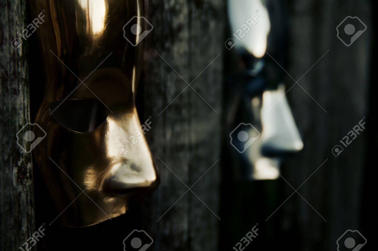 Trapped - Masks behind Weathered Fence Stock Photo - 15534860