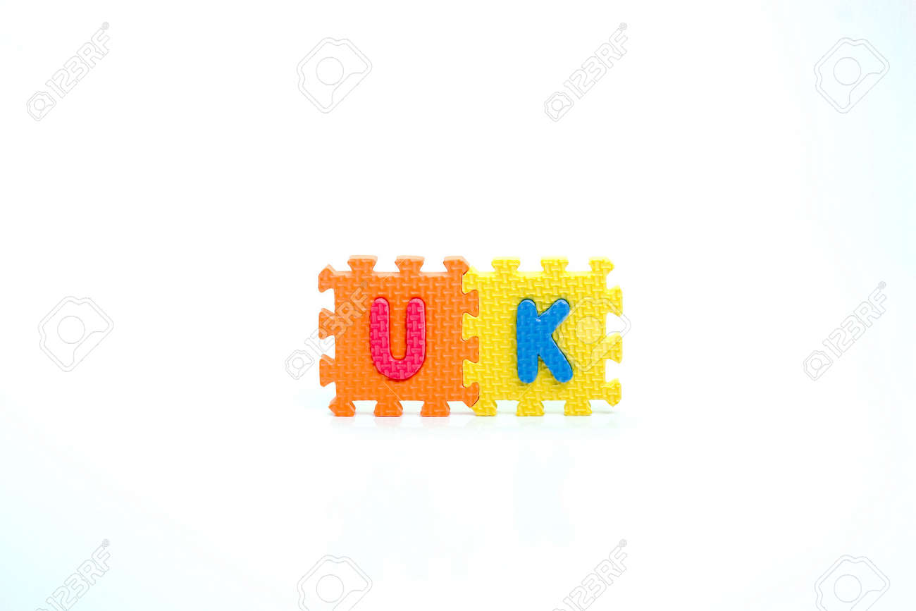 Colorful toy letters on spelling uk isolated in white background Stock Photo - 1015584