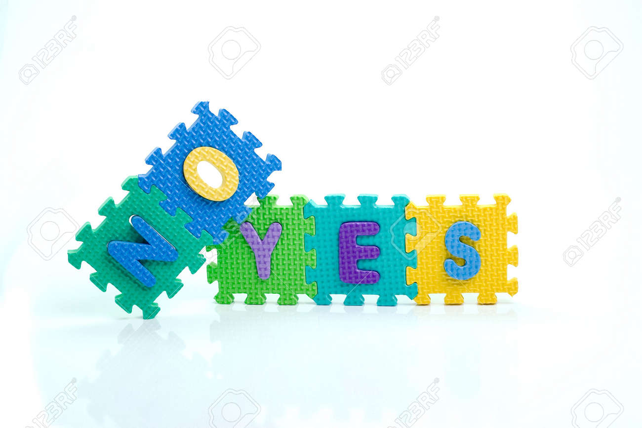Colorful toy letters on spelling yes no isolated in white background Stock Photo - 1015614