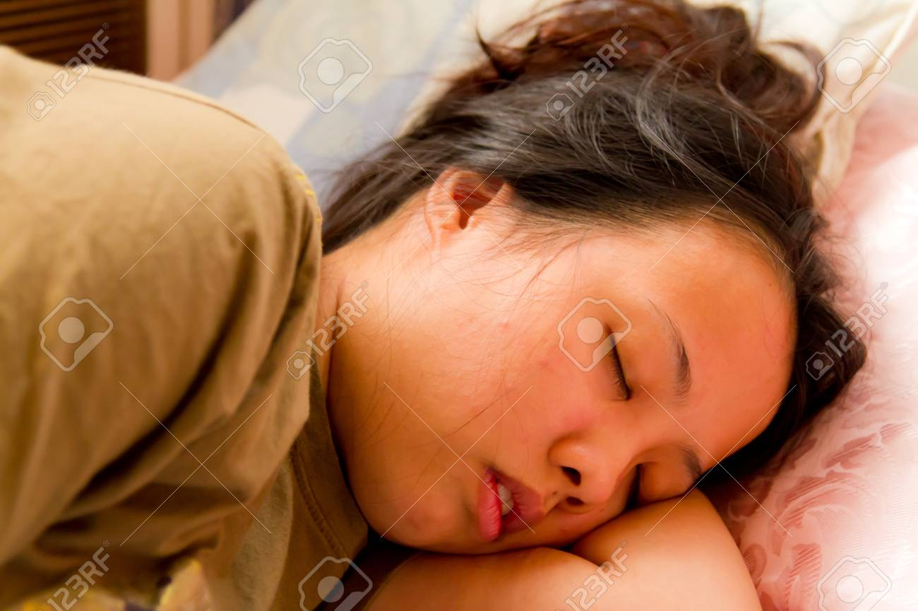 Asian woman closed her eyes and sleeping on bed - 12354301
