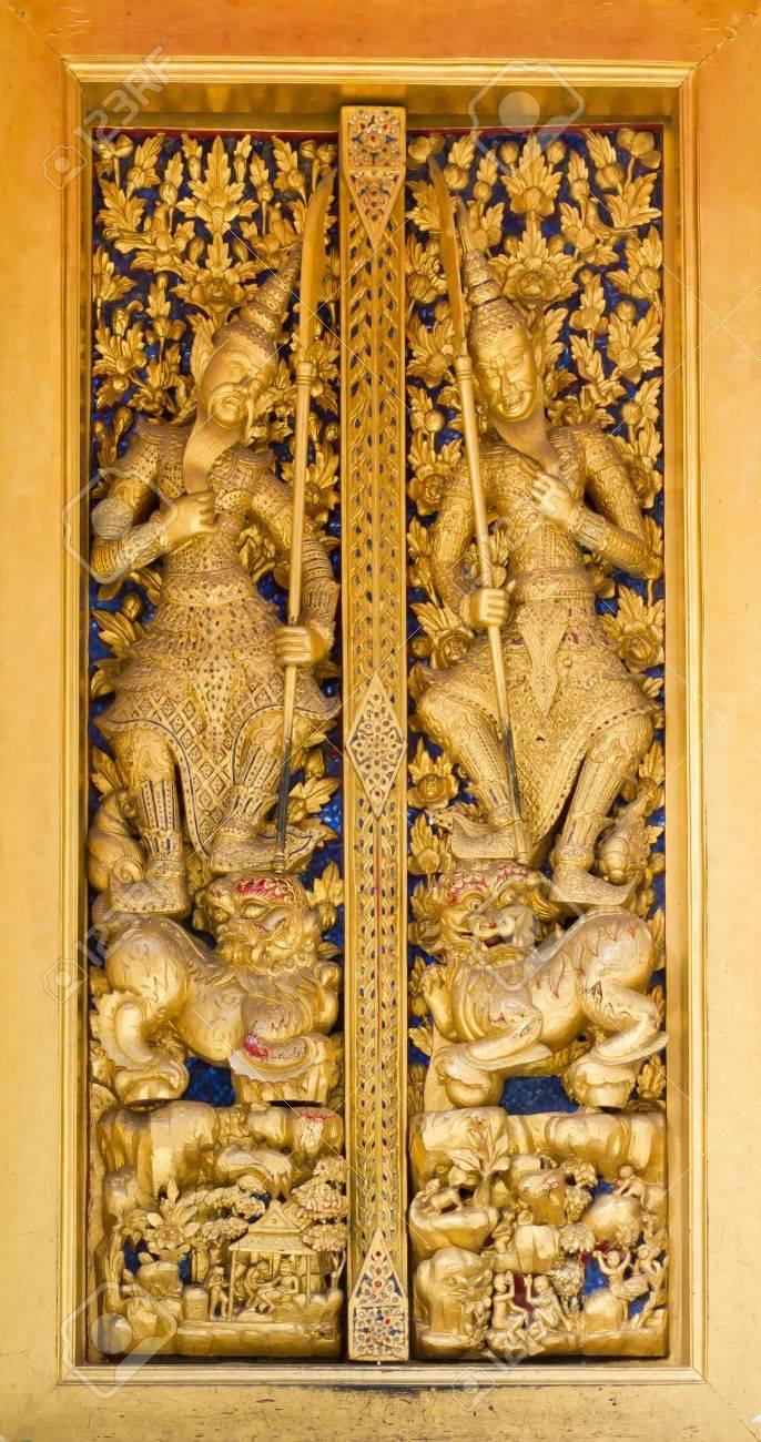 Golden Thai Design Craft On Wooden Door In Temple Of Emerald Stock