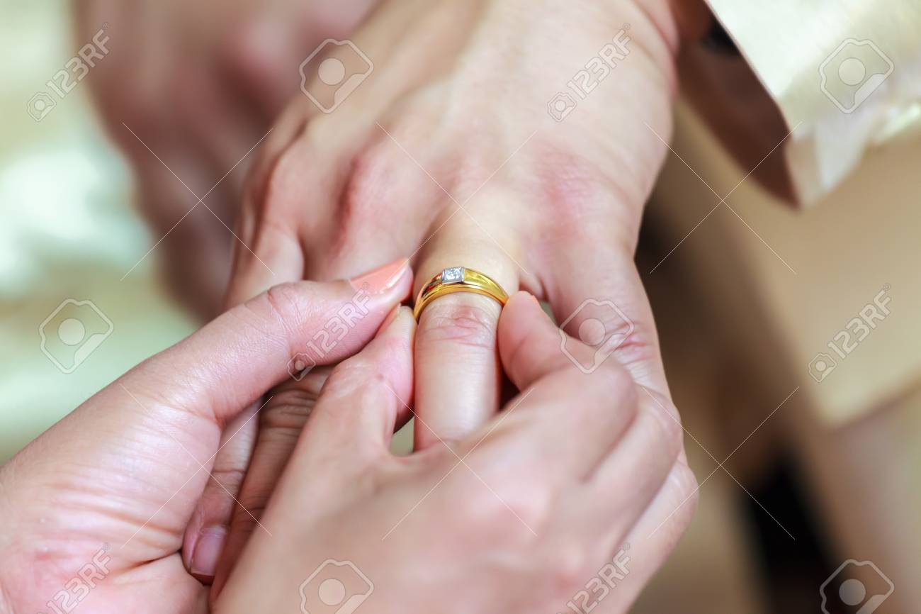 Bride Holding Groom\'s Hand And Wearing Ring On Finger Stock Photo ...
