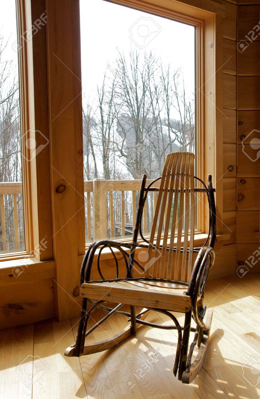 Rustic Wood Rocking Chair By Window Stock Photo   4536076