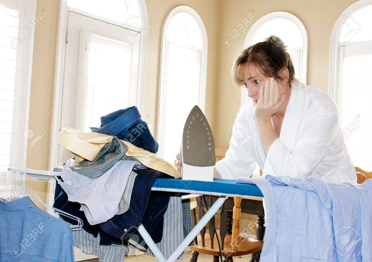ironing too many shirts Stock Photo - 4741446