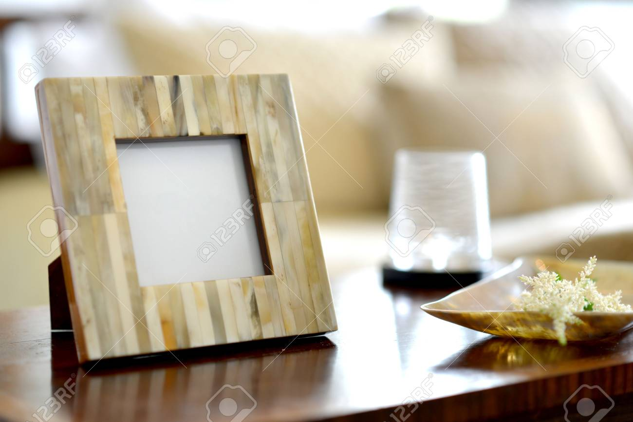 Natural Horn Picture Frames In A Bedroom Setting Stock Photo ...