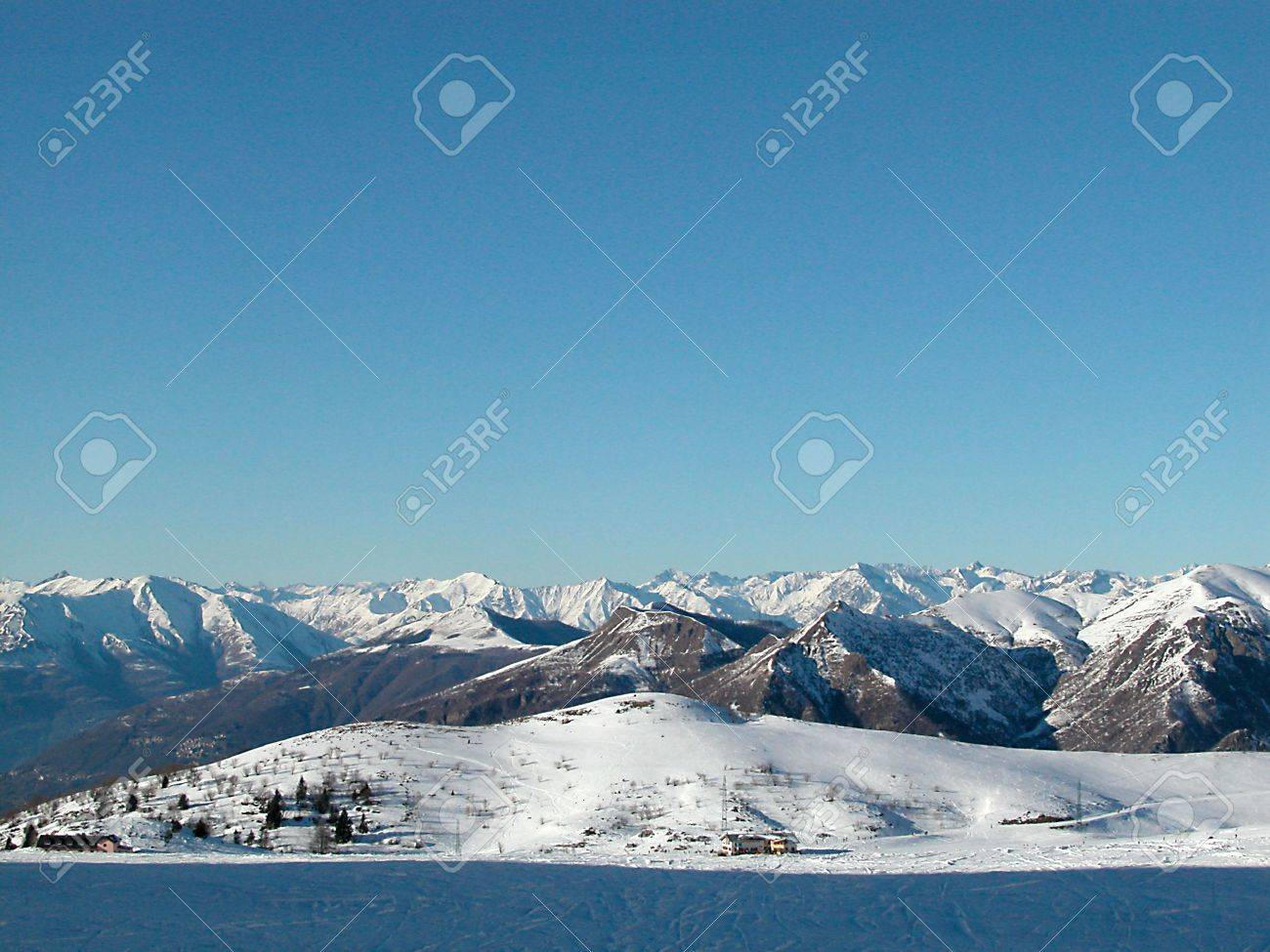 Panoramic view of Alps mountains covered of snow in wintertime, Italy Stock Photo - 4905478