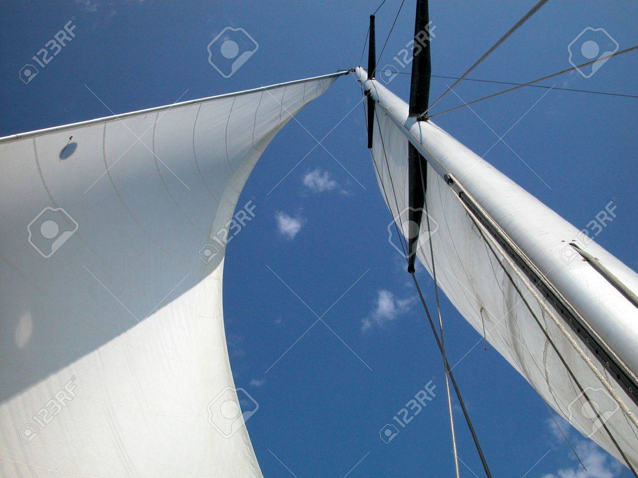 A view looking upwards at the mast, sail and rigging of a yacht underway Stock Photo - 4935985