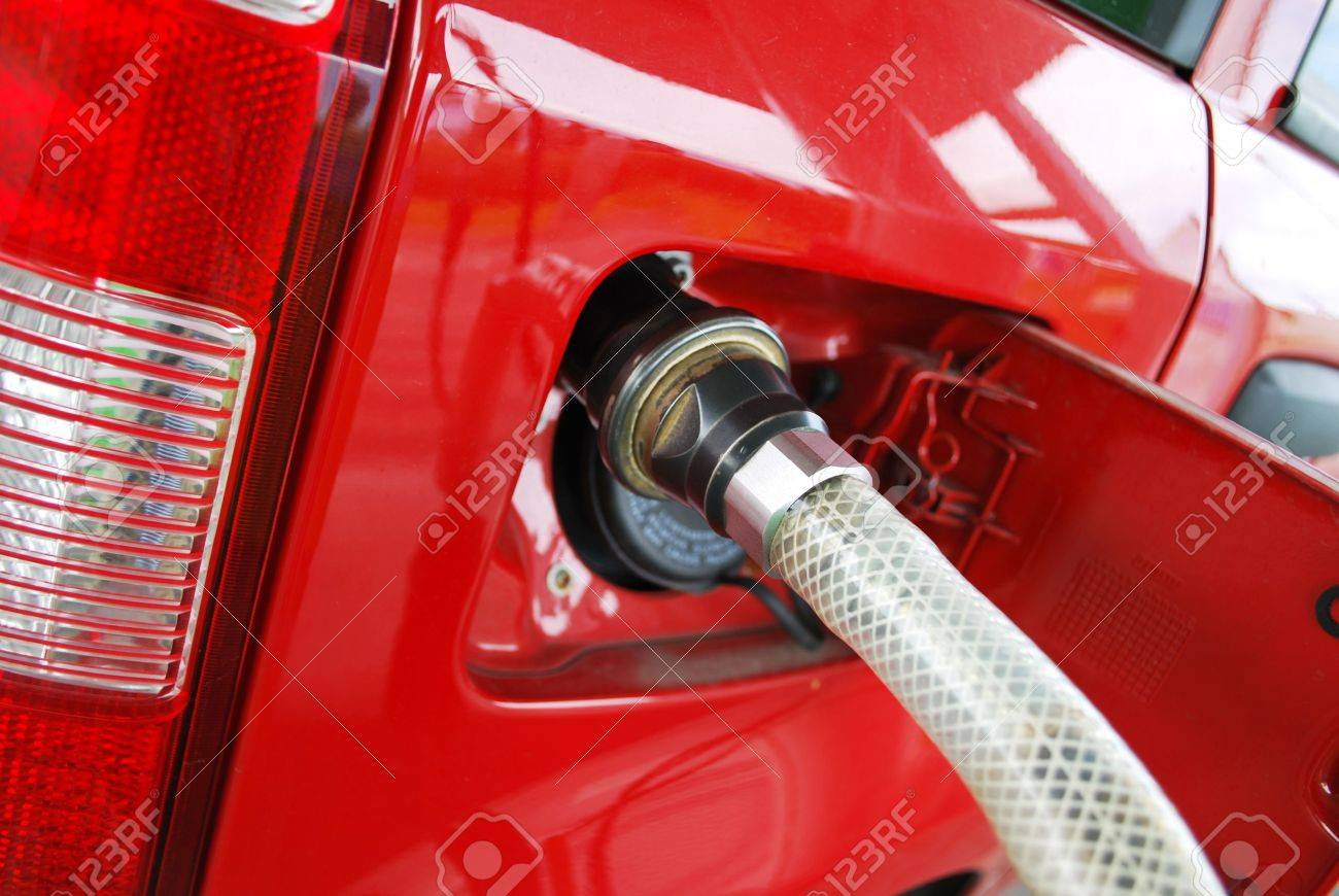 Ecologic methane red car fueling detail Stock Photo - 6578484