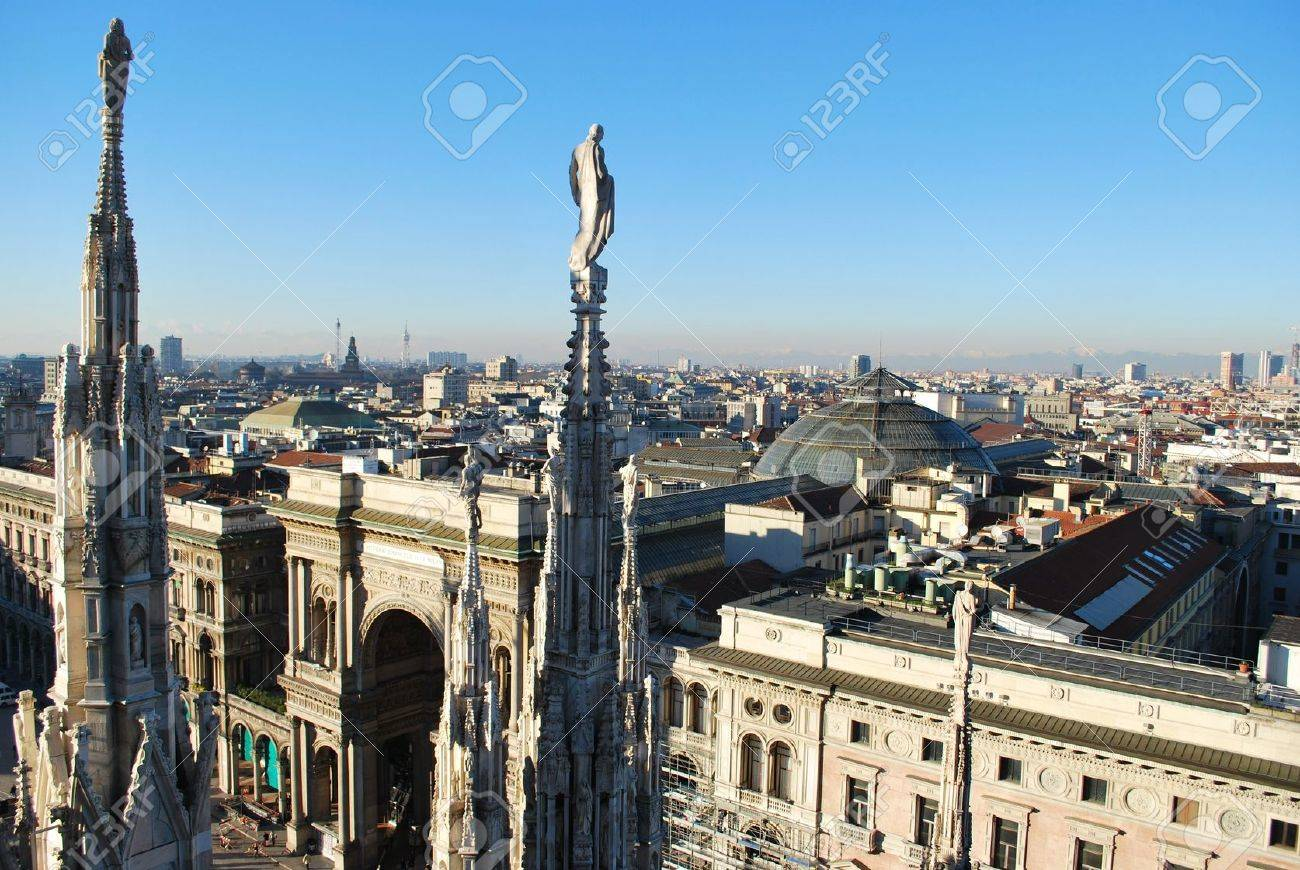 Landscape panoramic view of Milan from Duomo cathedral roof, Vittorio Emanuele gallery entrance in background, Lombardy, Italy Stock Photo - 8731374