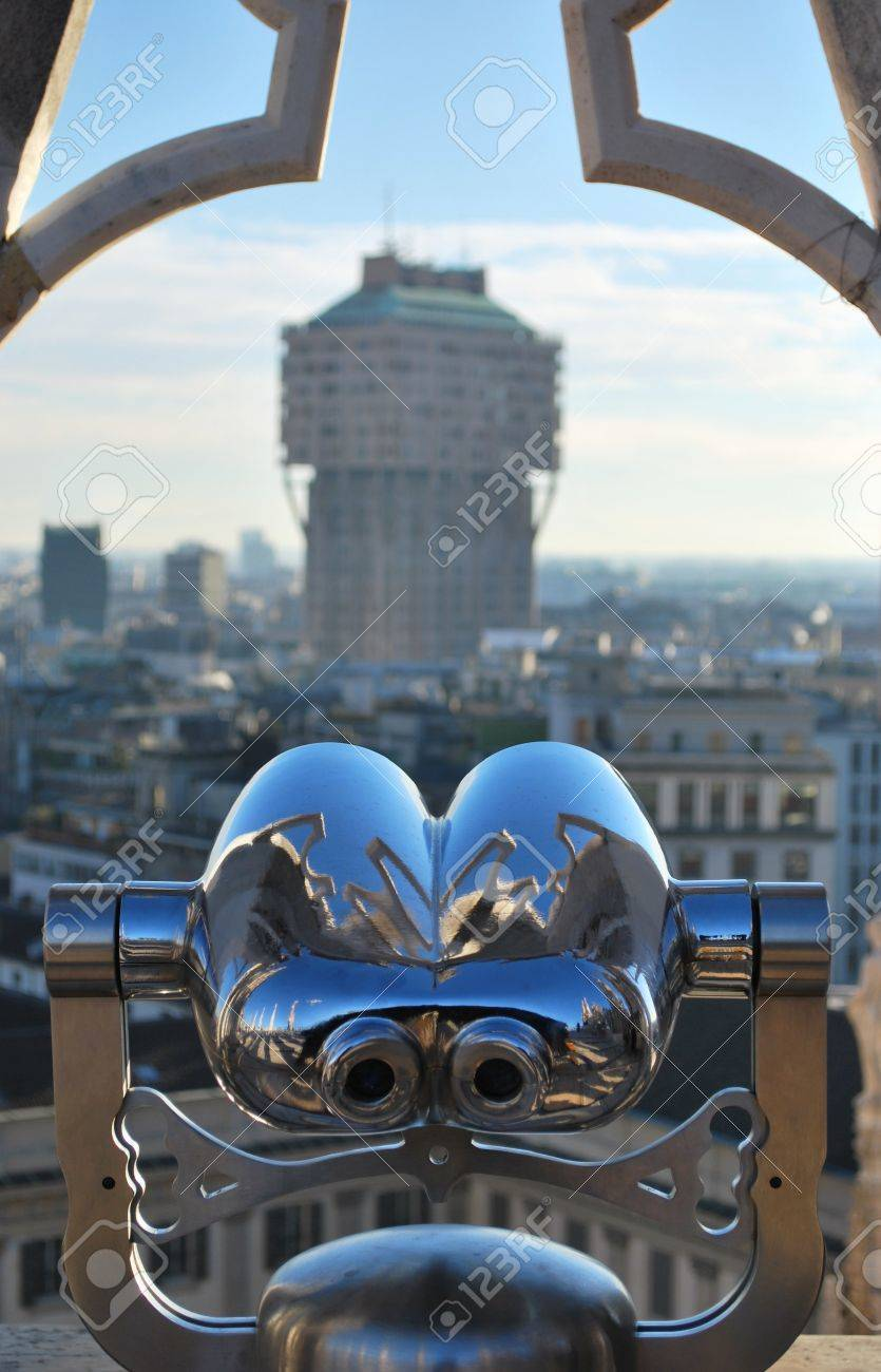 Binoculars telescope looking Milan panorama and Velasca Tower from the roof of the Duomo cathedral, Lombardy, Italy Stock Photo - 8731366