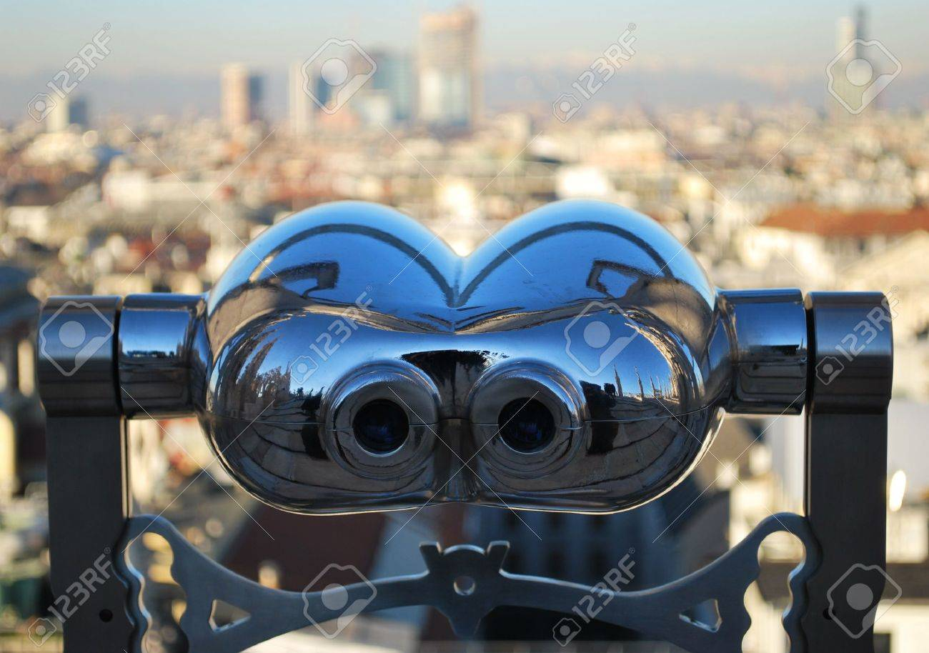 Binoculars telescope looking Milan panorama from the roof of the Duomo cathedral, Lombardy, Italy Stock Photo - 8731364