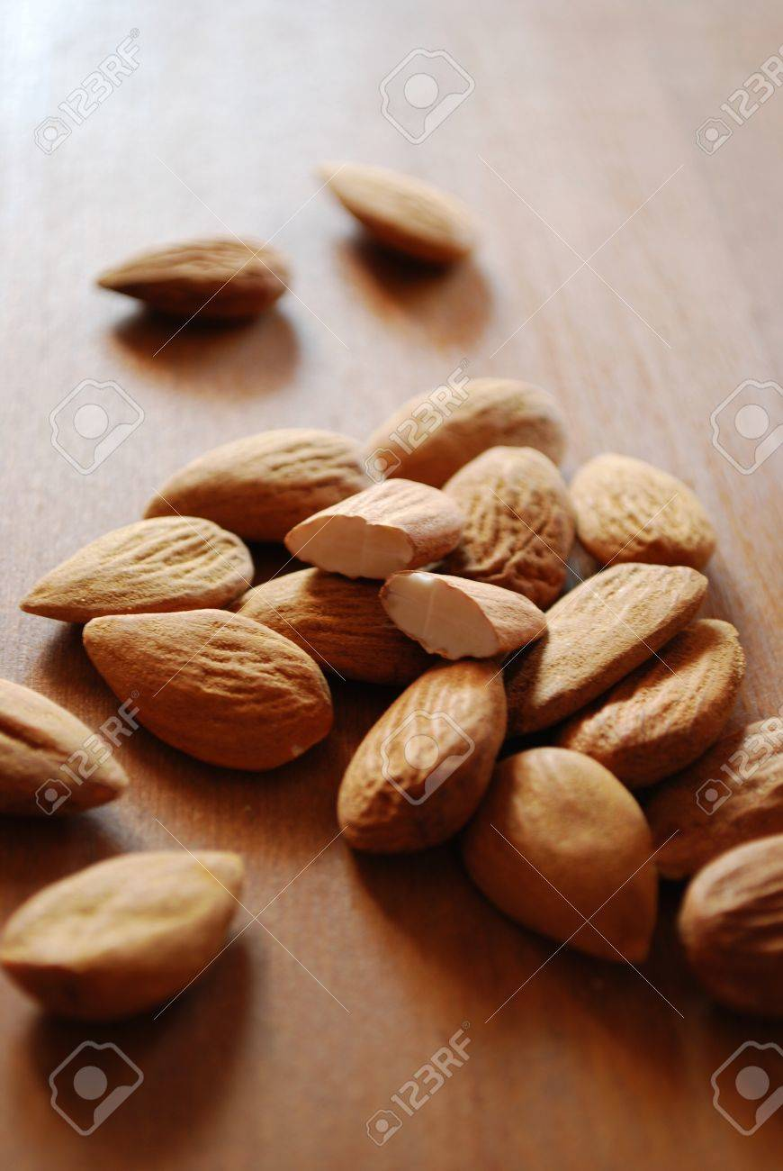 Shelled almonds on natural wooden table background Stock Photo - 8853282