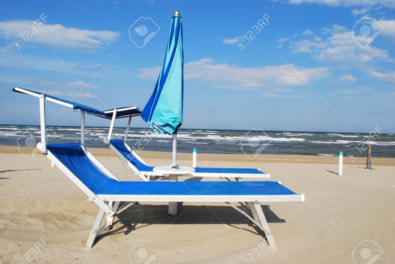 Beach chair with umbrella - Blue Beach Chairs And Umbrella Rimini Italy Stock Photo 9767202