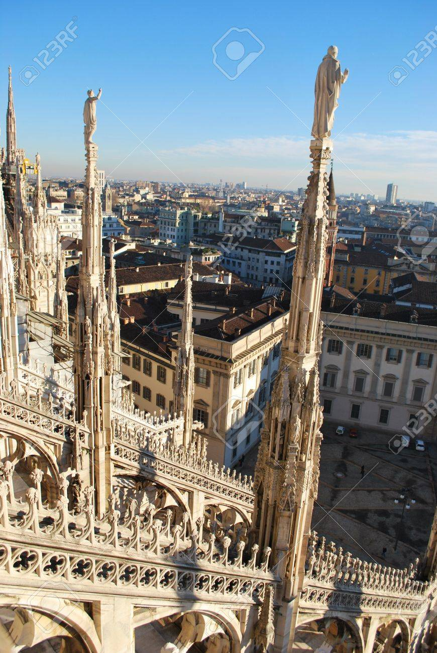 Landscape backview of Milan from Duomo cathedral roof, Royal Palace in background, Lombardy, Italy Stock Photo - 9889132