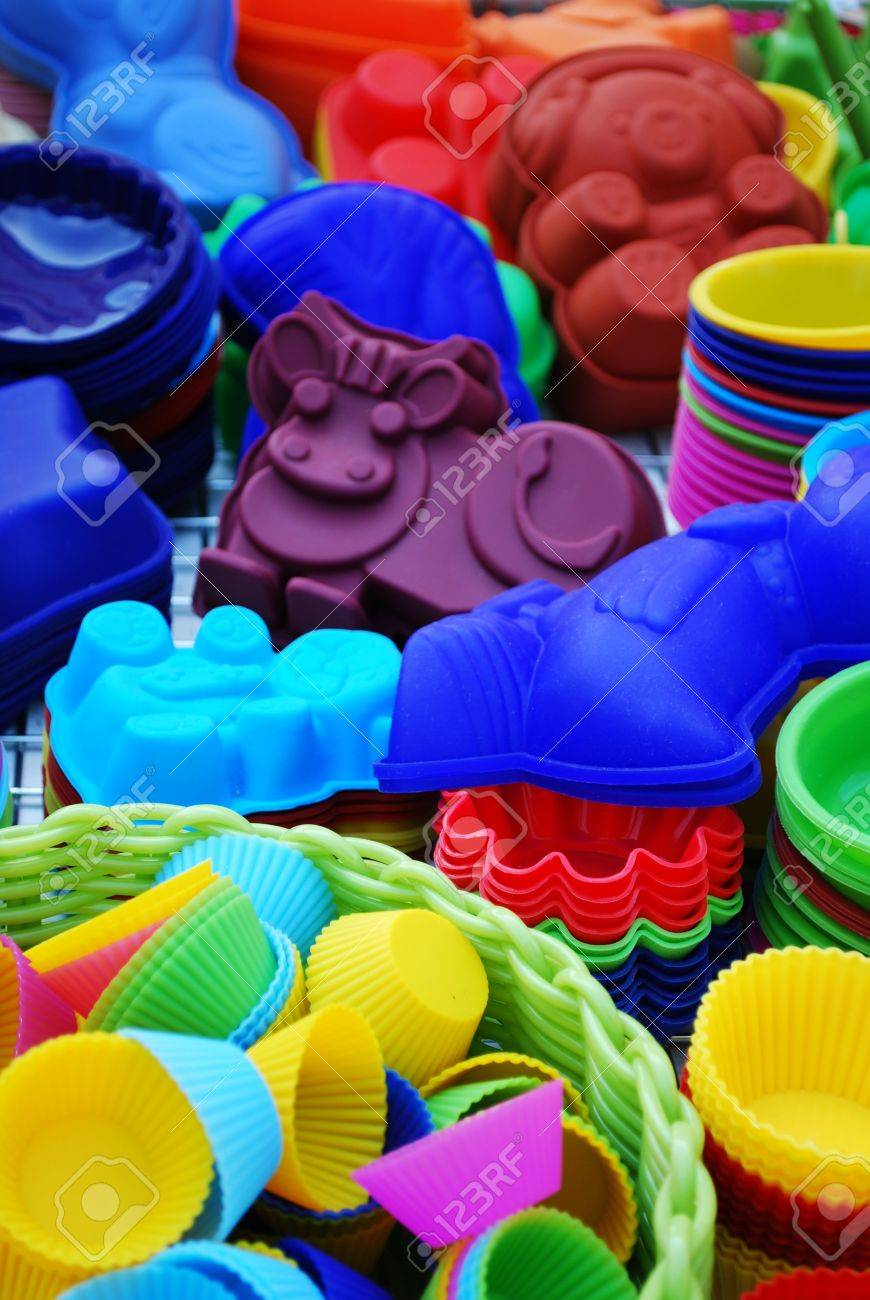 Colorful and differently shaped silicone baking pans as a background Stock Photo - 12068025