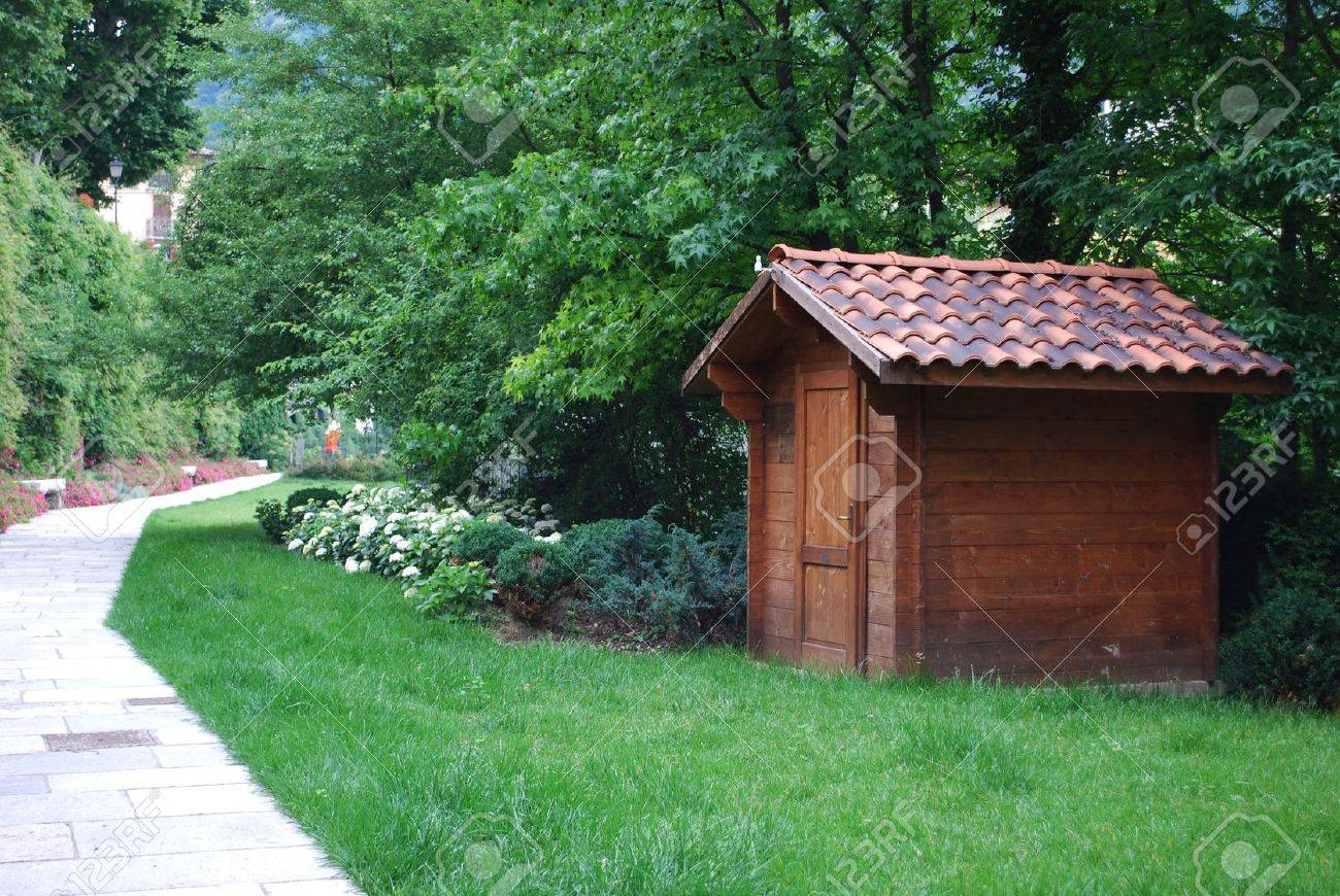 Wooden garden tool shed in a beautiful park Stock Photo - 13796588