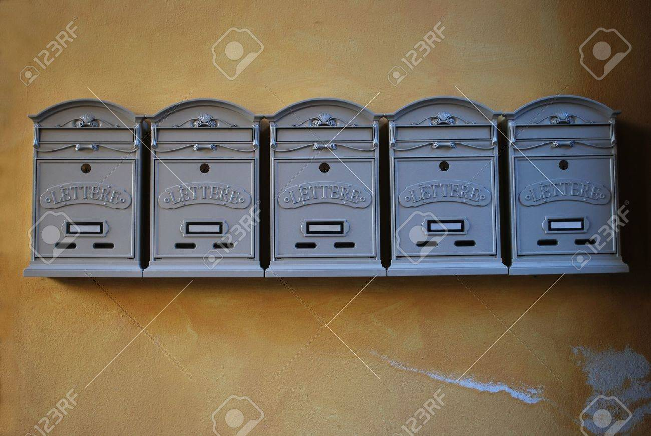 A row of gray color mailboxes in vintage style on old yellow wall Stock Photo - 22966433