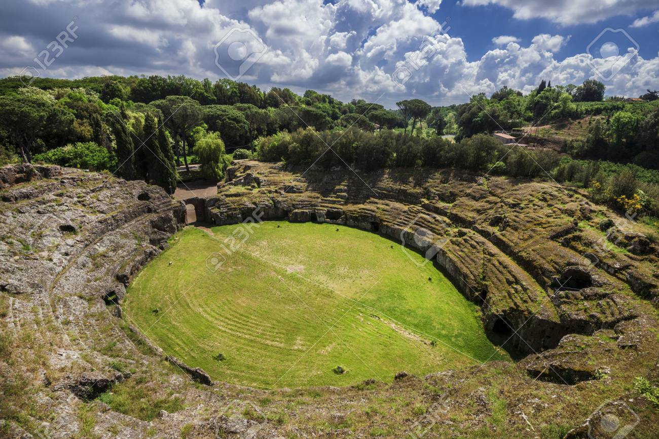 Ancient roman tuff stone amphitheater in the town of Sutri with clouds, near Rome Banque d'images - 82447757