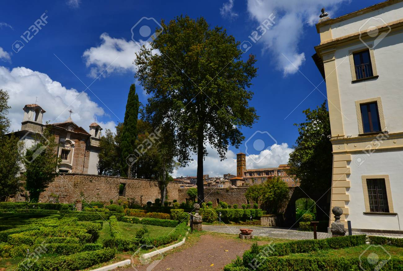 Villa Savorelli public park in the ancient medieval town of Sutri, with old church and beautiful clouds Banque d'images - 82670486