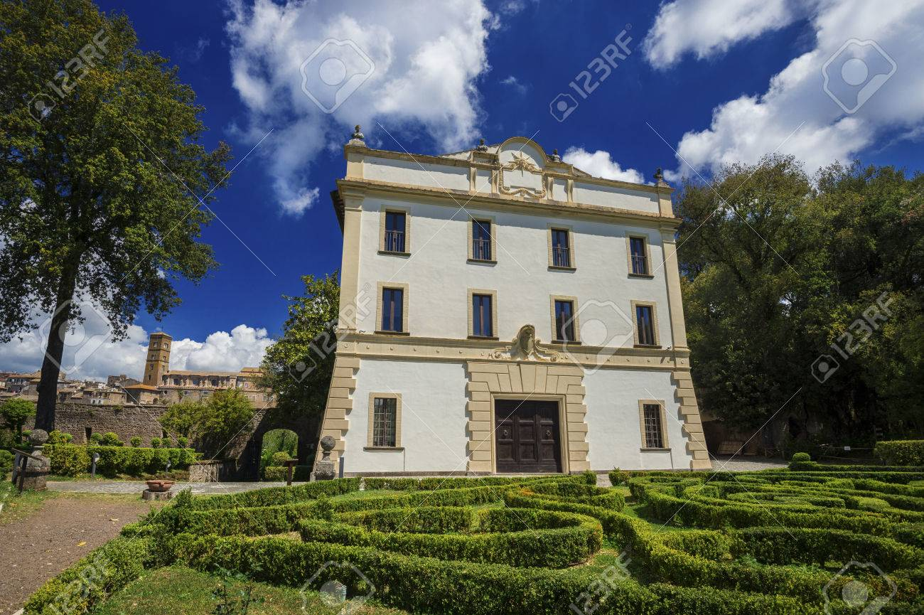 Villa Savorelli public park in the ancient medieval town of Sutri, with old church and beautiful clouds Banque d'images - 82876062