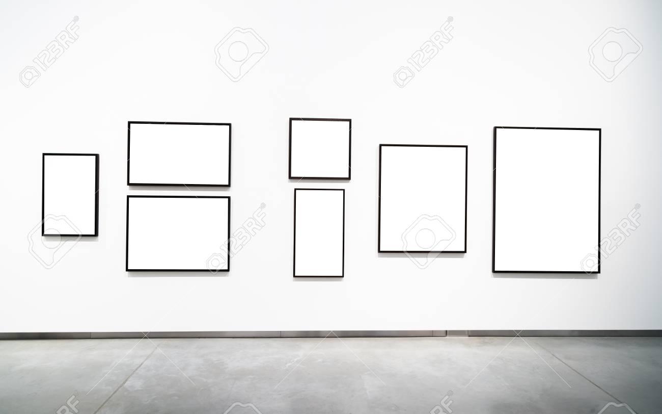 Blank empty golden frame on white background. Art gallery, museum..
