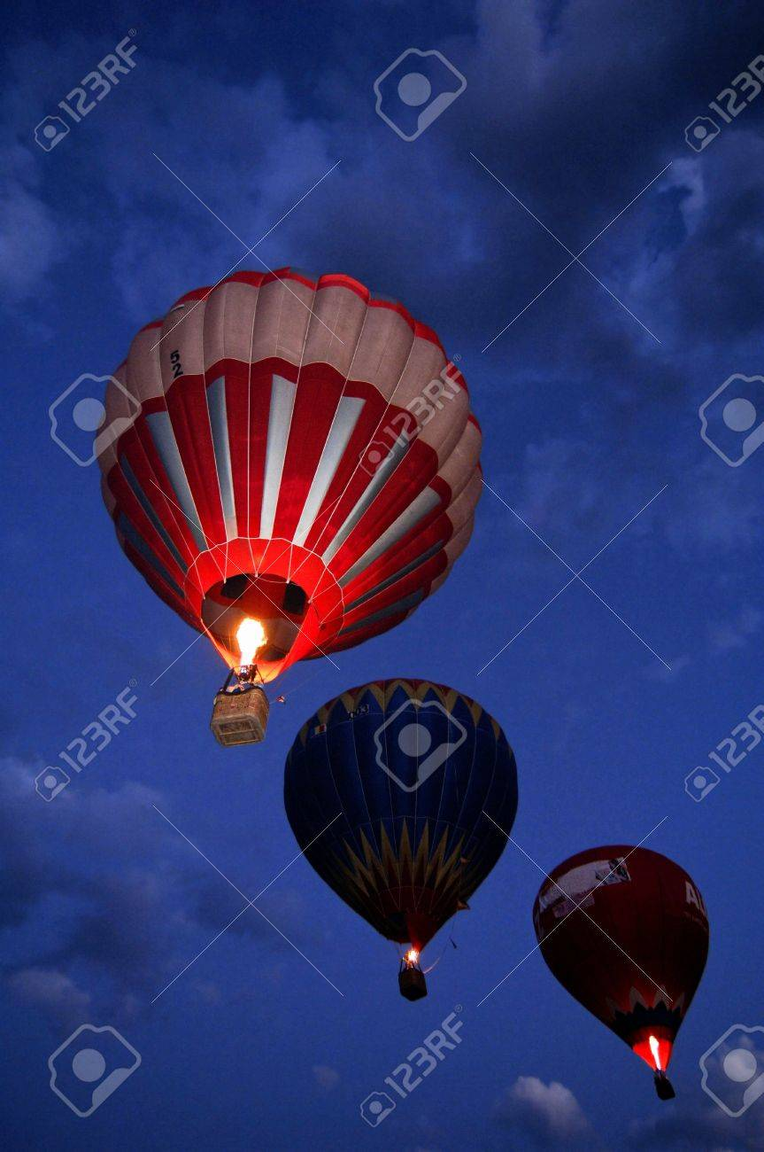 three air balloons flying by night stock photo picture and