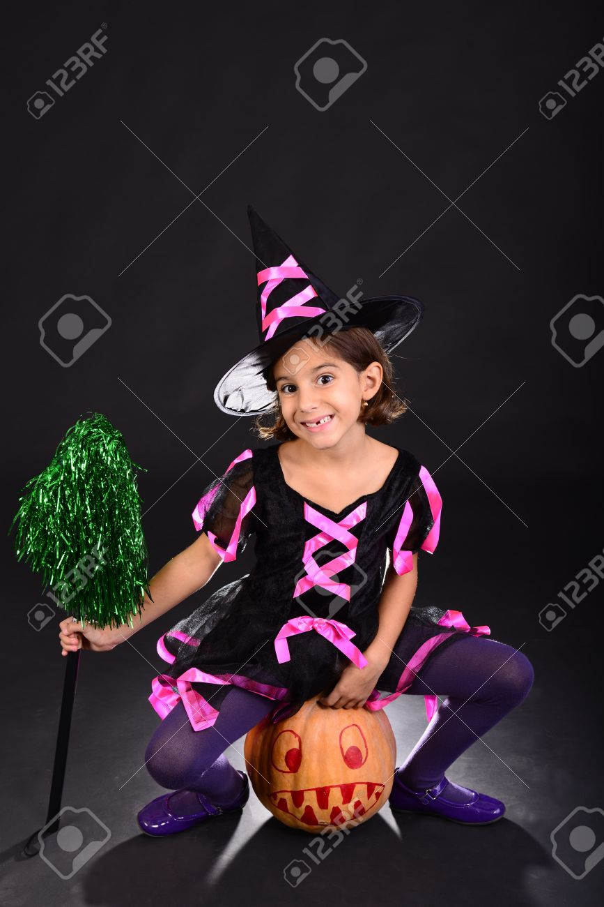 Funny Little Girl Dressed In Witch Costume Sitting On Halloween ...