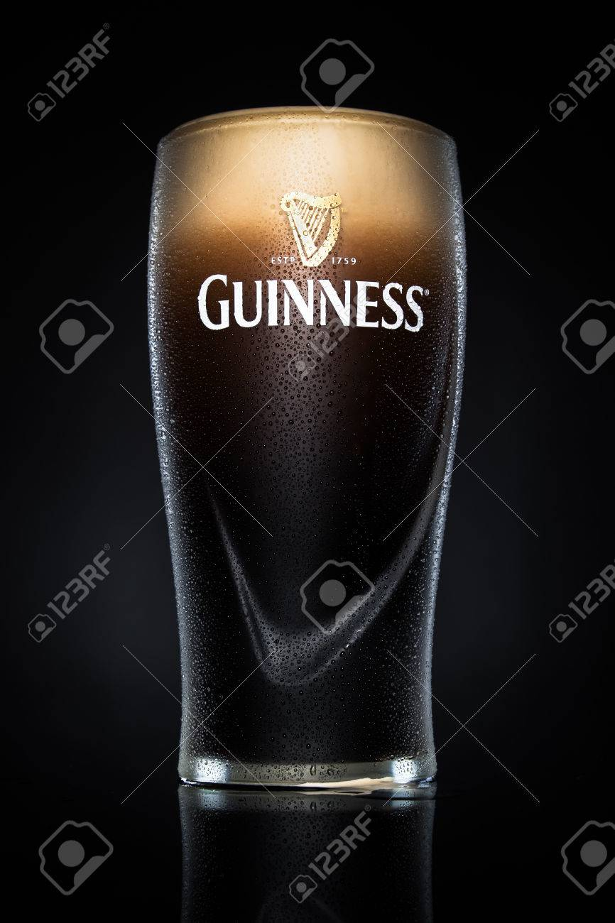 Pint of Guinness, the popular Irish beer on a black background. Guinness is one of the most successful beer brands worldwide. Standard-Bild - 42696946