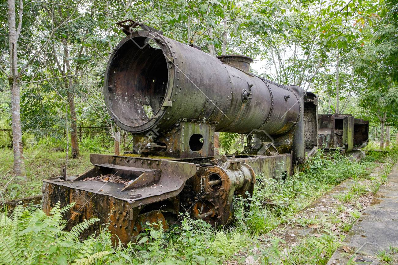 Old 2nd World War Japanese steam locomotive rusting away in a rubber plantation near Pekanbaru, Sumatra, Indonesia. Standard-Bild - 43484125