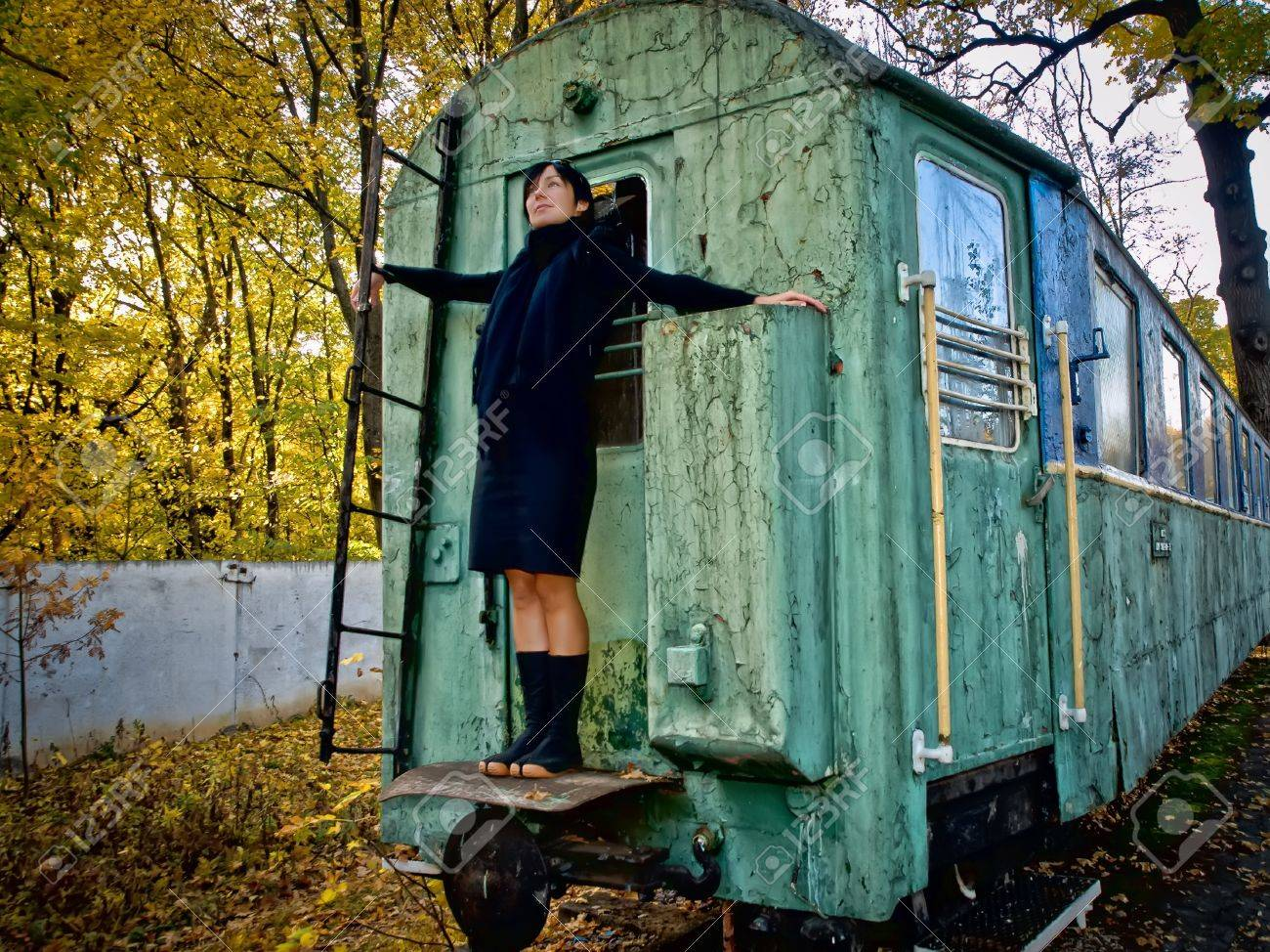 Woman strands on back side of old squalid rail coach Stock Photo - 7311152