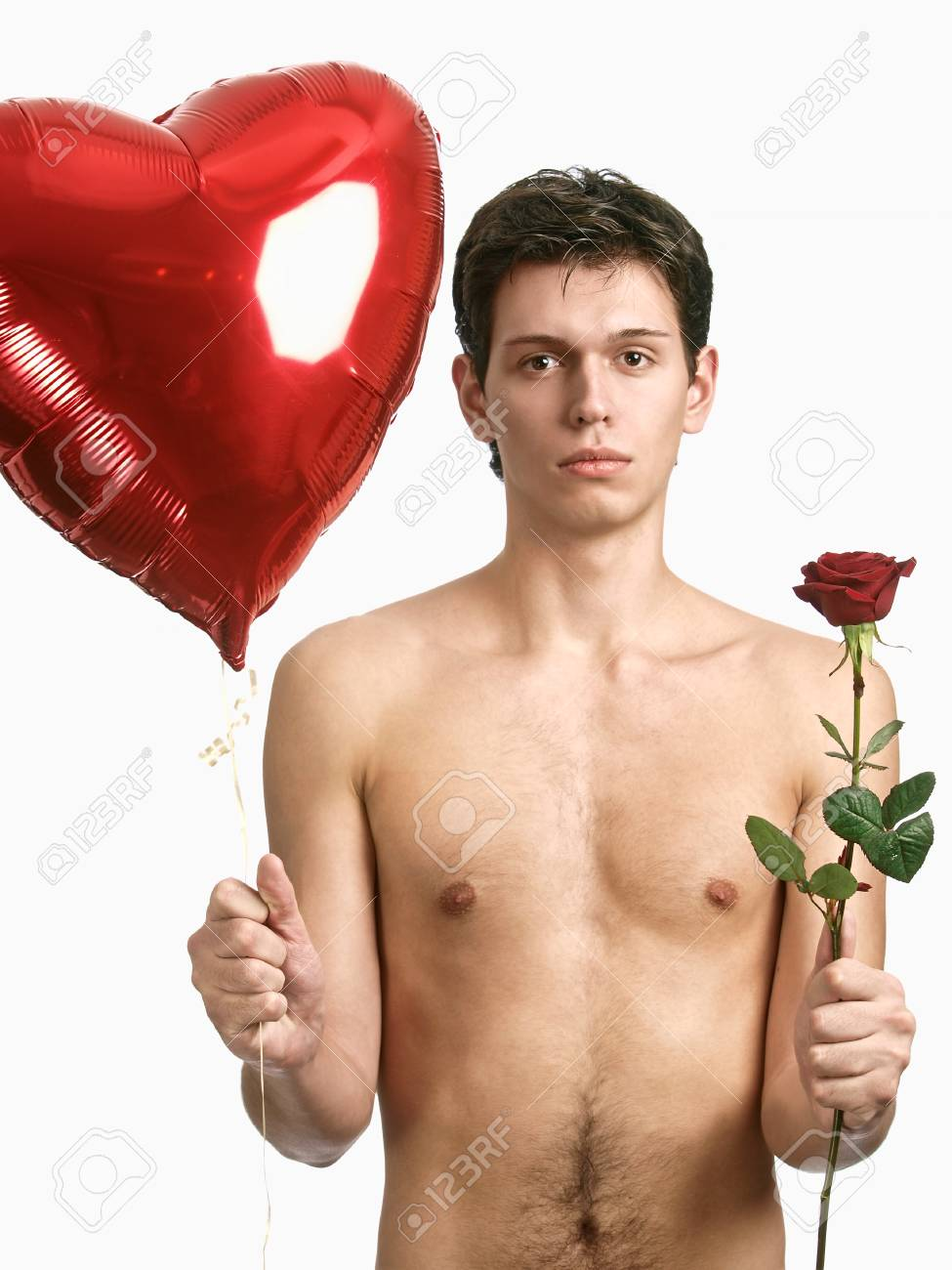 young handsome man with big heart and red rose Stock Photo - 8785927