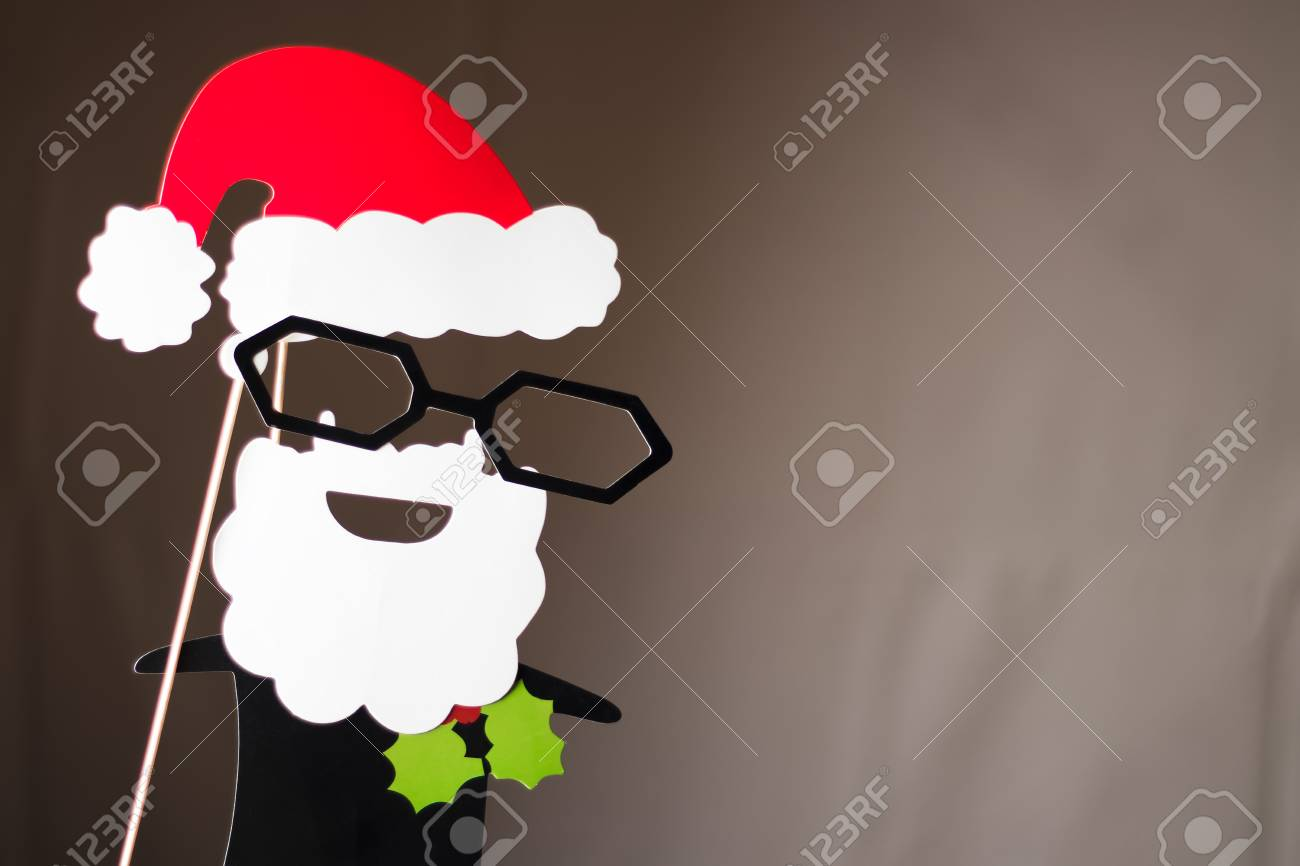 290997a1b1653 Christmas Santa Claus made out of photo booth props. Dark brown background.  Stock Photo