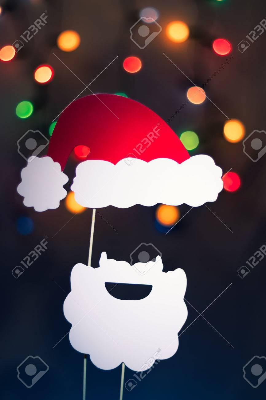 b985c30aa12e1 Christmas Santa Claus made of photo booth props. Hat and a beard. Christmas  lights