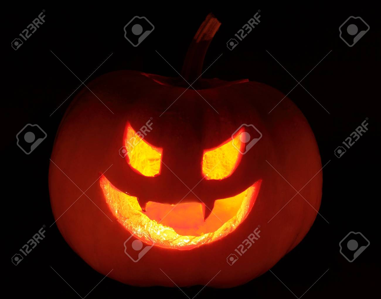 hallowen natural pumpkin with candles inside illuminating dark background Stock Photo - 16255636