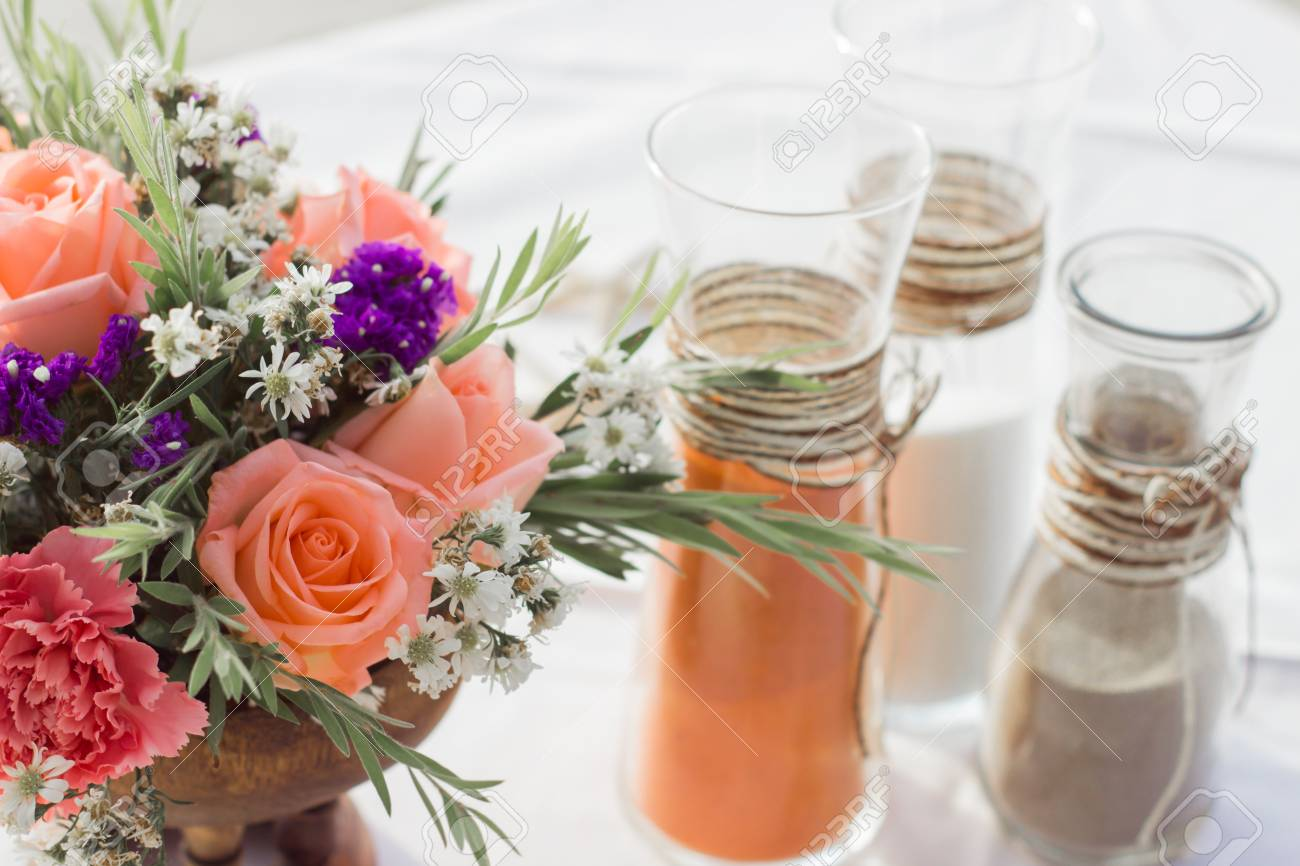 Sand Ceremony Wedding.Bouquets Flowers In Vase And Wedding Sand Ceremony On The Table