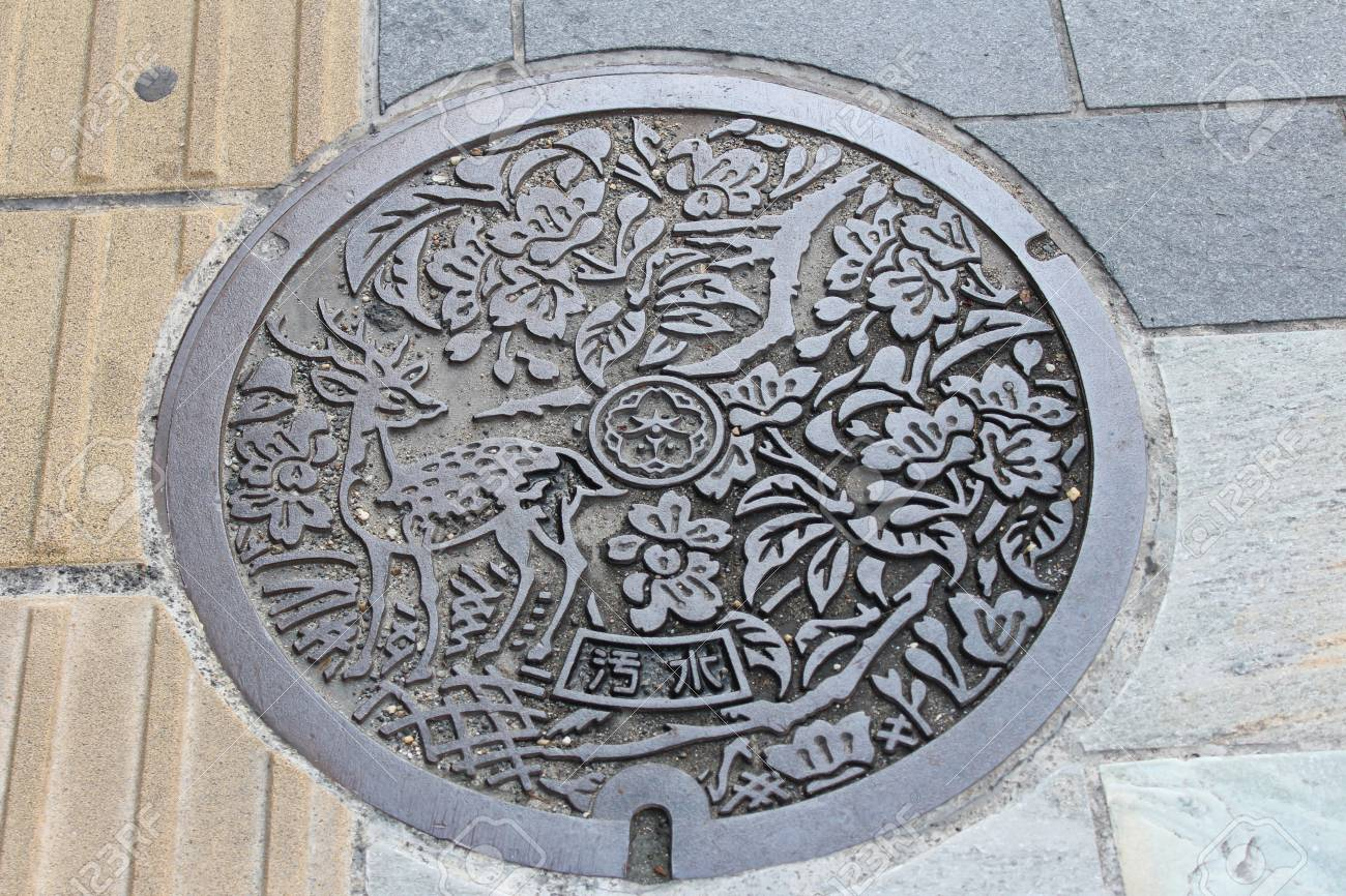 Artistic manhole cover with the deer and flowers carvings at