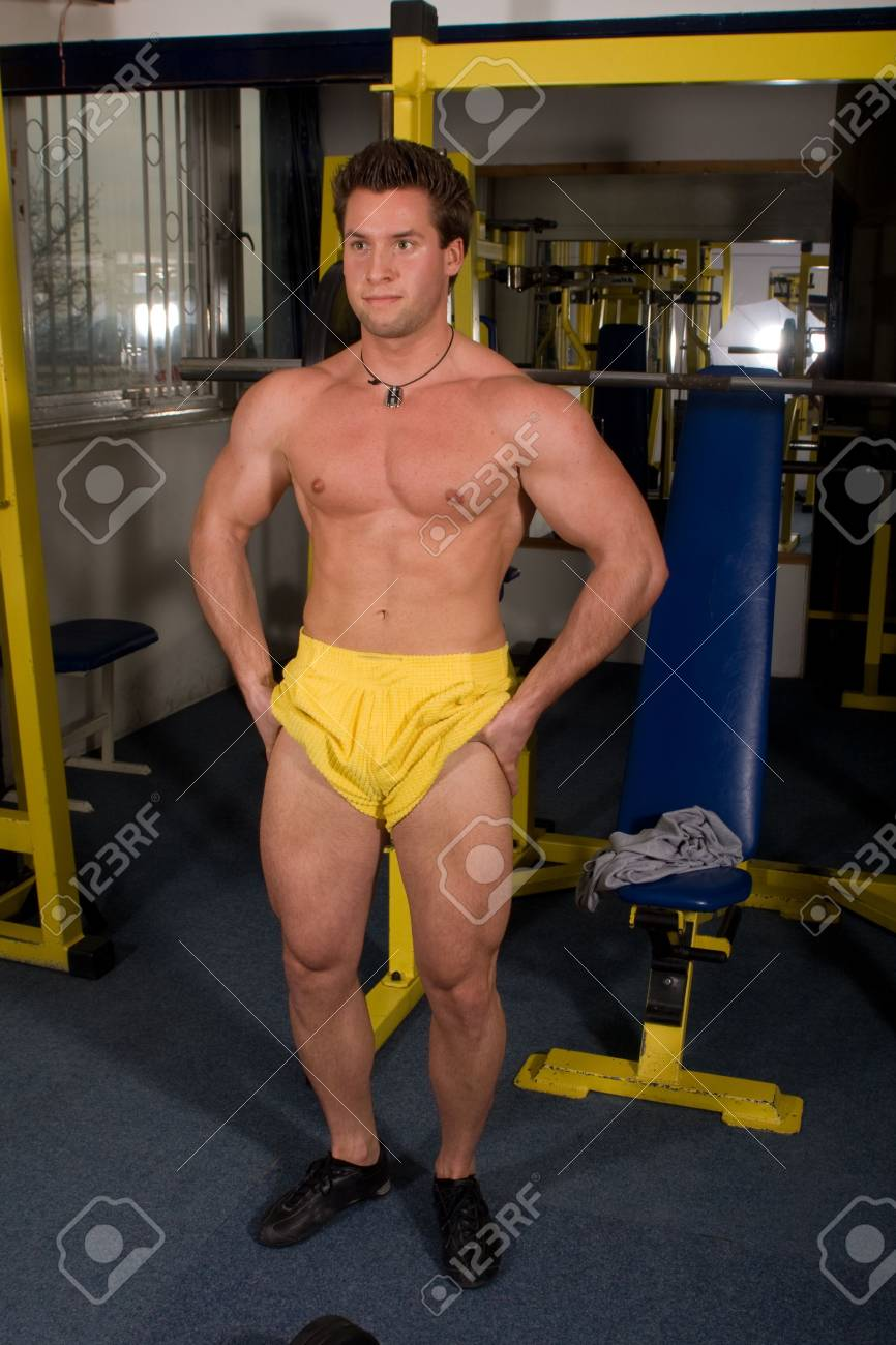 young bodybuilder posing in the gym Stock Photo - 4327821