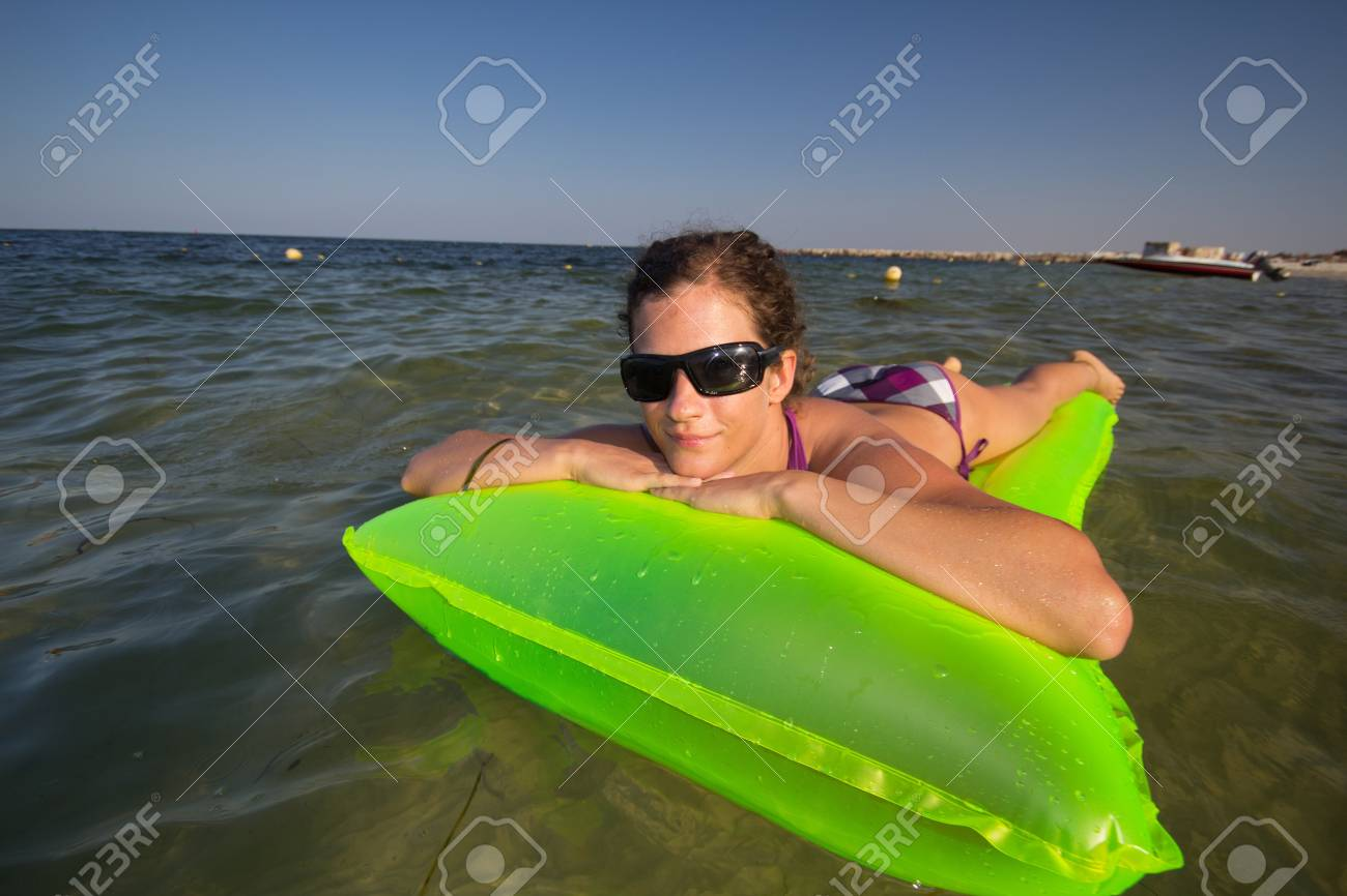 woman on the air-bed - holiday Stock Photo - 10278034