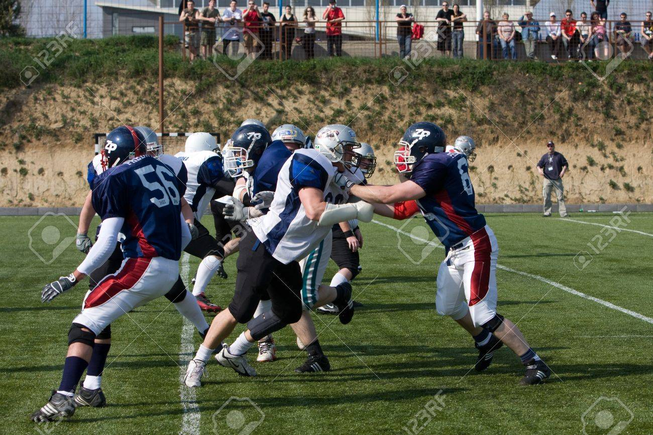 KOZARMISLENY - APRIL 4: Zala Predators (blue) and Pecs Gringos (white) american football teams participate in Hungarian Championship, April 4, 2009 in Kozarmisleny, Hungary. Stock Photo - 11728533
