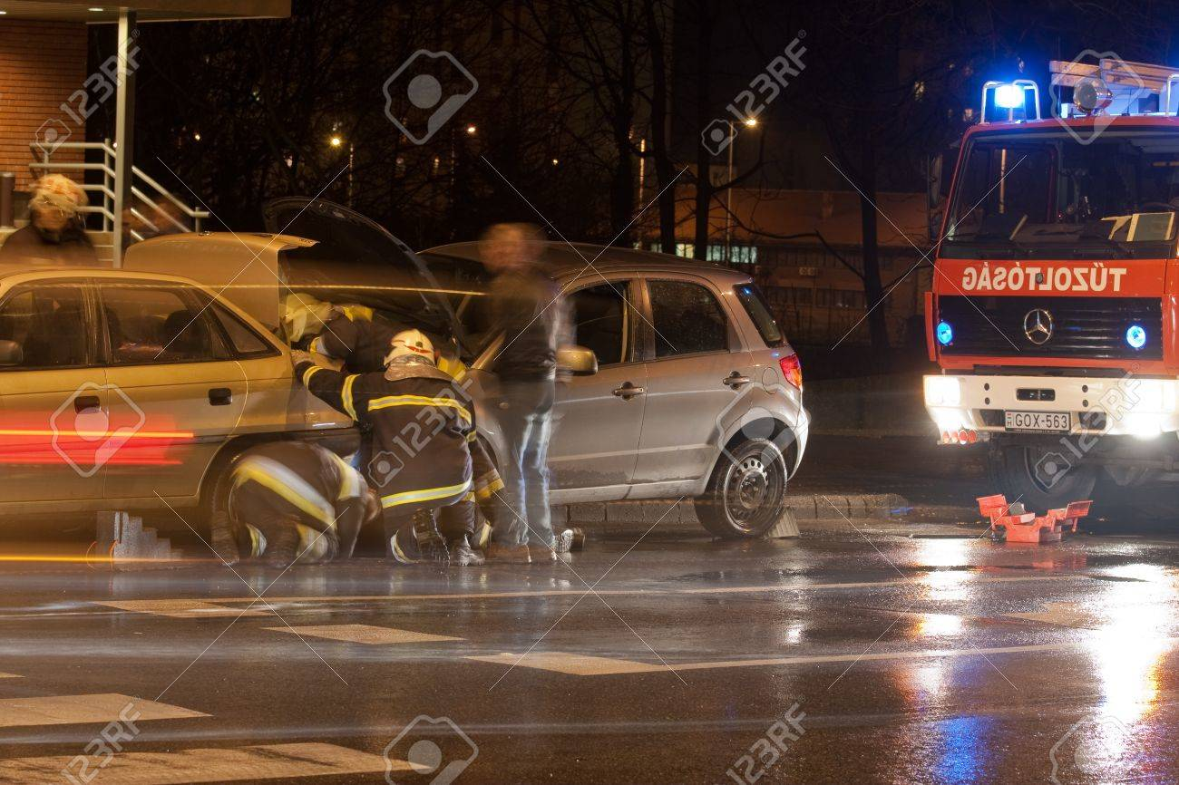 PECS, HUNGARY - DEC. 01: car crashed. Firefighter try to help the victim of car accident on Dec. 01, 2011 on Road 6 in Pecs, Hungary. Stock Photo - 12444623