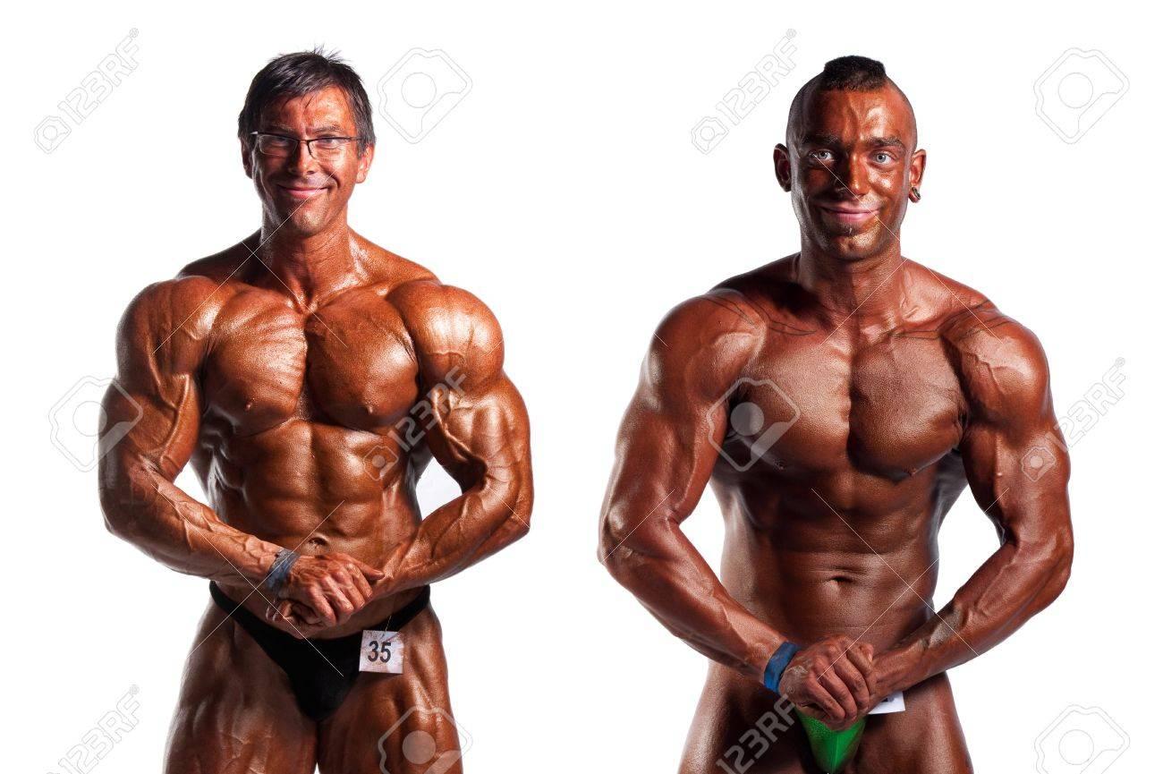 Bodybuilders Posing Over White Background Stock Photo
