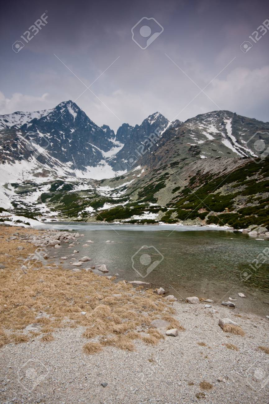 High Tatras with snowy peaks and lake Stock Photo - 17359256