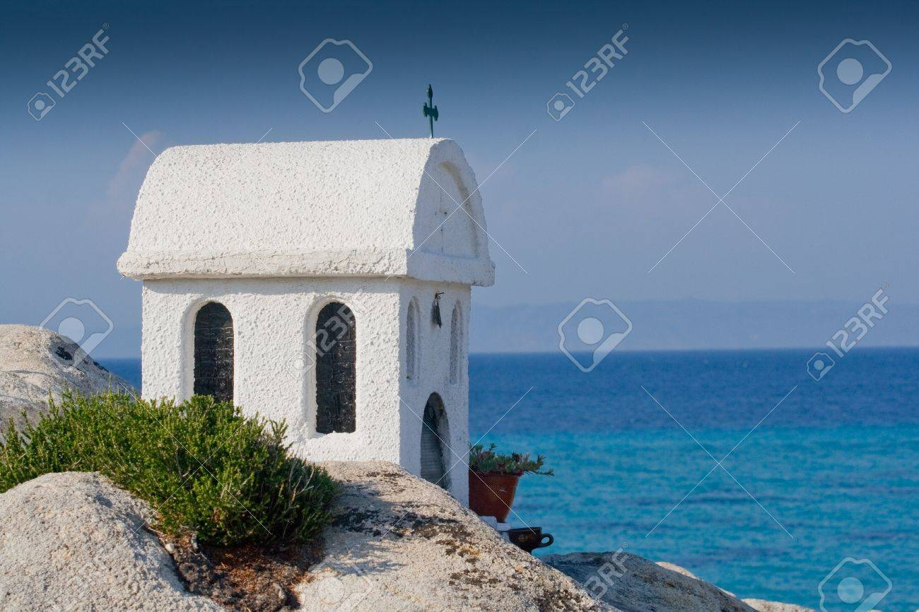 Small Greek chapel with blue sky Stock Photo - 21819593