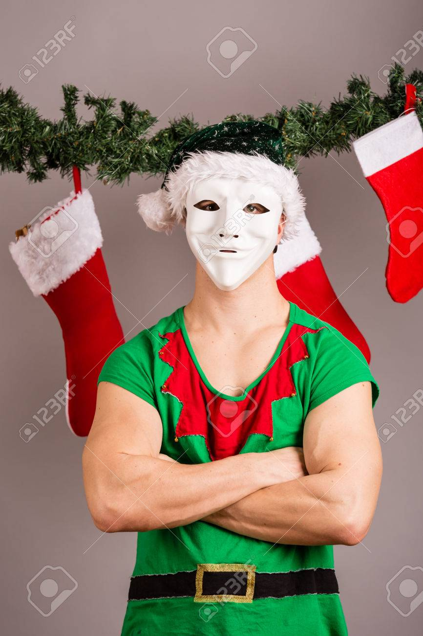 Funny Christmas Elf In Green Suits And Mask Stock Photo, Picture And ...