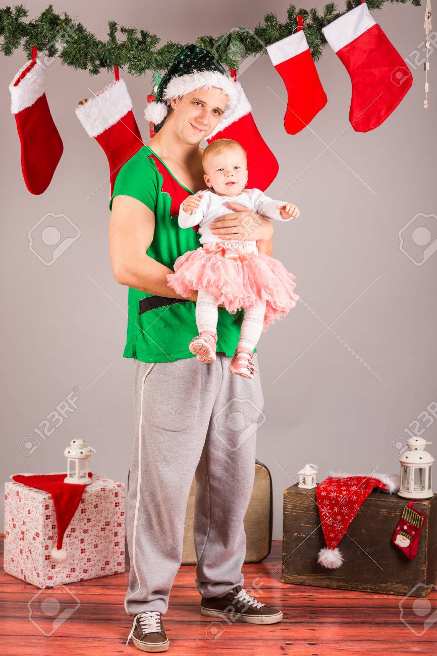 Funny Christmas Elf With Baby Girl In Studio Stock Photo, Picture ...
