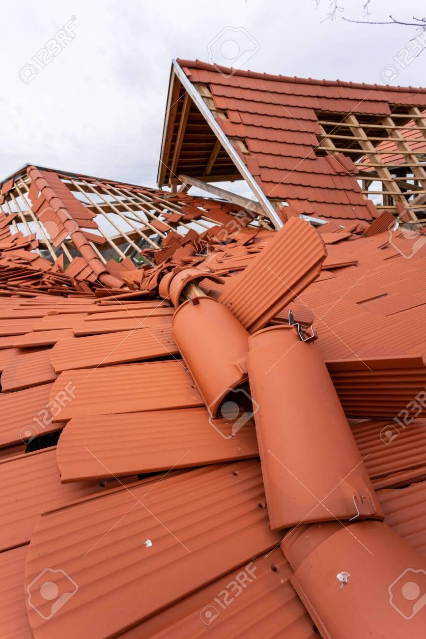 Broken roof after a storm - 146706226