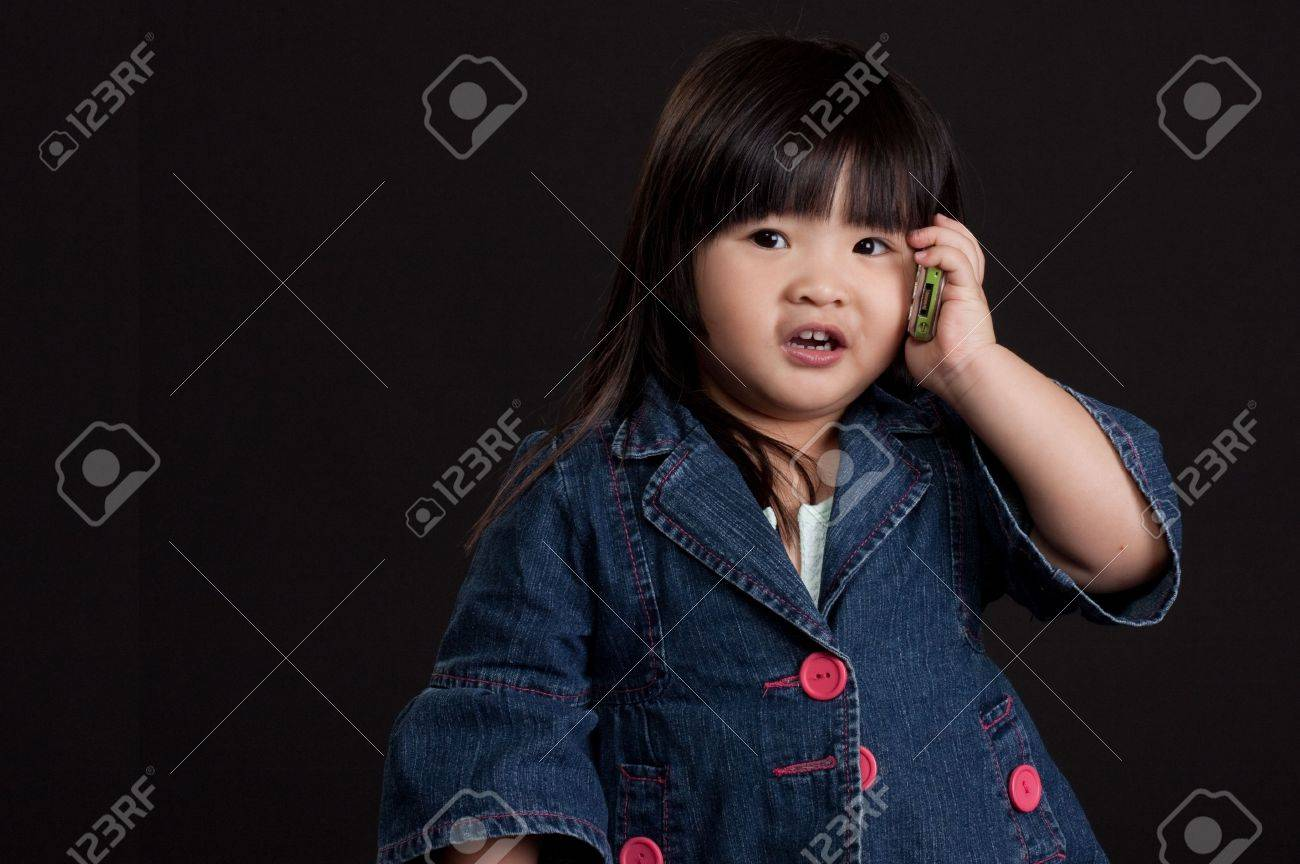 Cute little chinese girl using mobile phone Stock Photo - 6331345