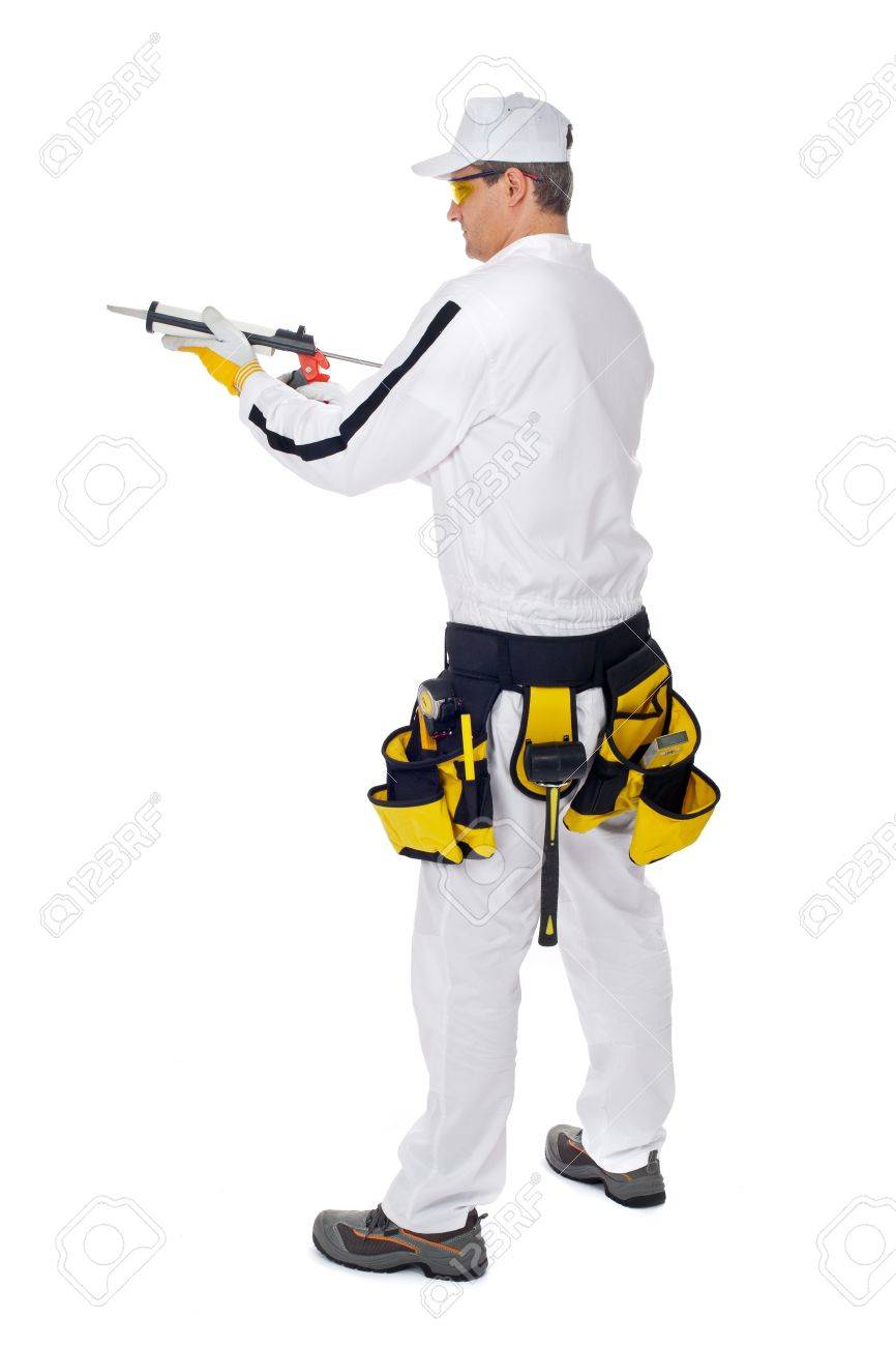 construction worker in white overalls holding a gun silicone stock